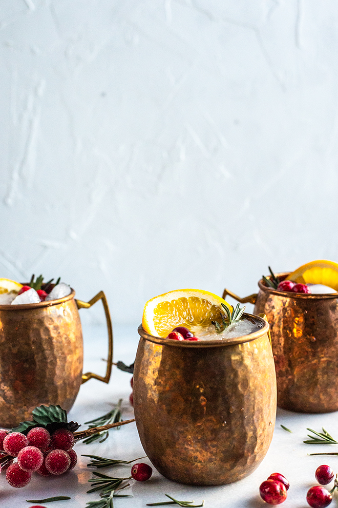 cranberry orange moscow mules in copper mugs