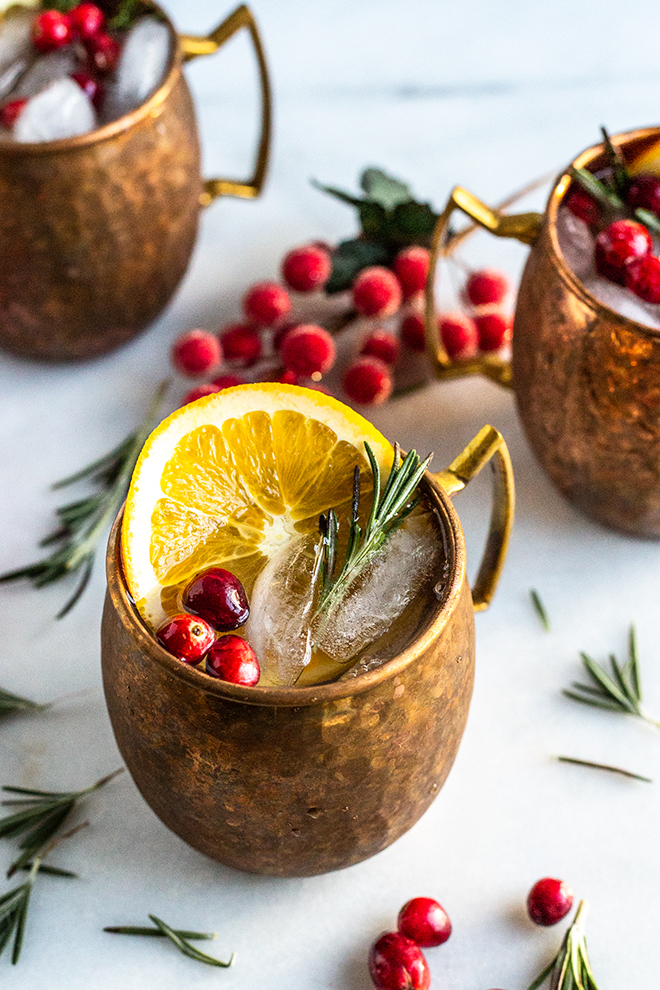 These festive yuletide Cranberry Orange Yule Mules come together with healthier cranberry orange syrup, ginger beer and of course vodka!