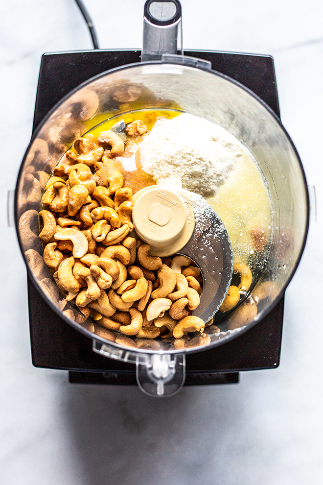 cashews, coconut flour, ghee, and all the making for cashew crust in a food processor.