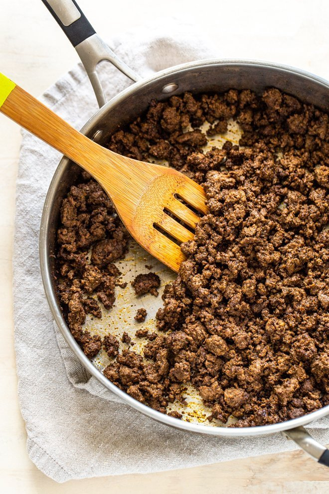 ground elk meat with taco seasoning in a pan