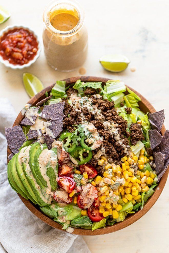 healthy elk taco salad on a white background