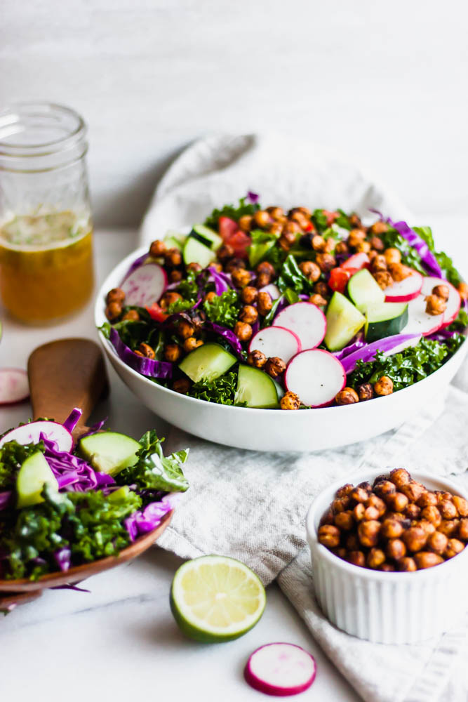 Looking for a fun salad? Try crispy chili roasted chickpeas with massaged kale & cabbage tossed in probiotic ginger lime vinaigrette!