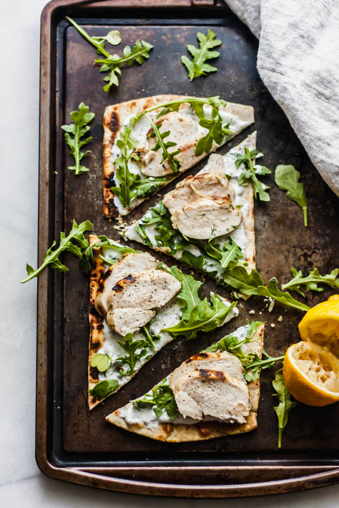 If you need an easy, throw together dinner or starter this juicy lemon chicken on top of grilled flatbread with the most refreshing dill yogurt sauce topped with arugula is just the thing!