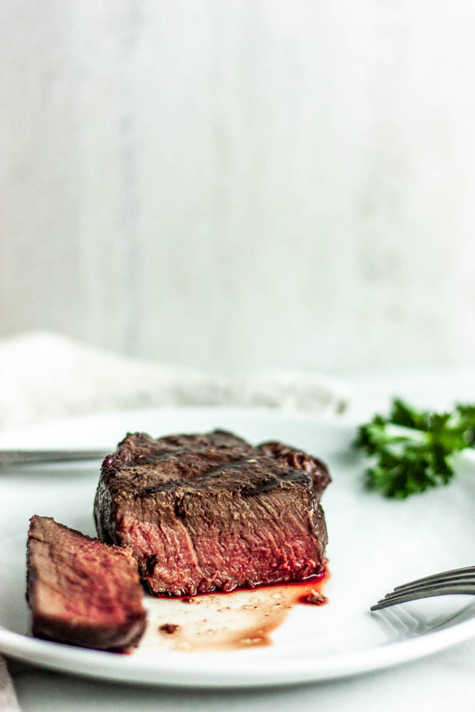 Showing you how to make the perfect steak using a reverse sear and grill technique - slow roasting in the oven to just under the perfect temperature and finishing on the grill. A perfect, even cook every time.
