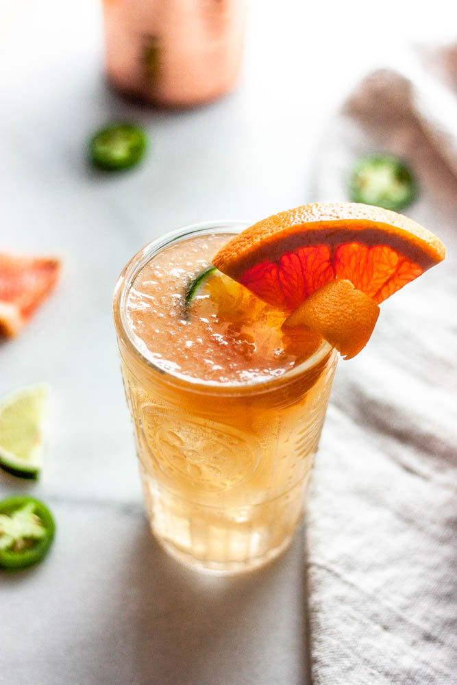 A Spicy Jalapeno Paloma made with fresh grapefruit, jalapenos, agave and of course...tequila. All topped off with grapefruit sparkling water!