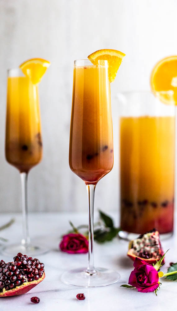 Serving up thisRefined Sugar Free Tequila Sunrise Punch with lightly, agave sweetened pomegranatejuice, OJ and of course, tequila.
