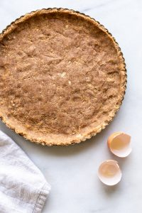 unbaked paleo pie crust on a white background