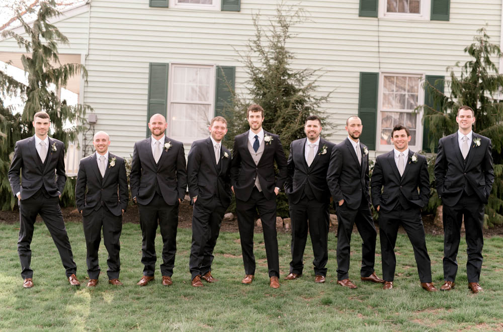 navy and grey groom's suit