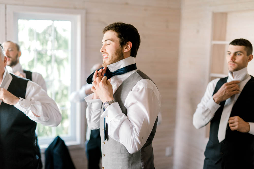 navy and grey groom's suit