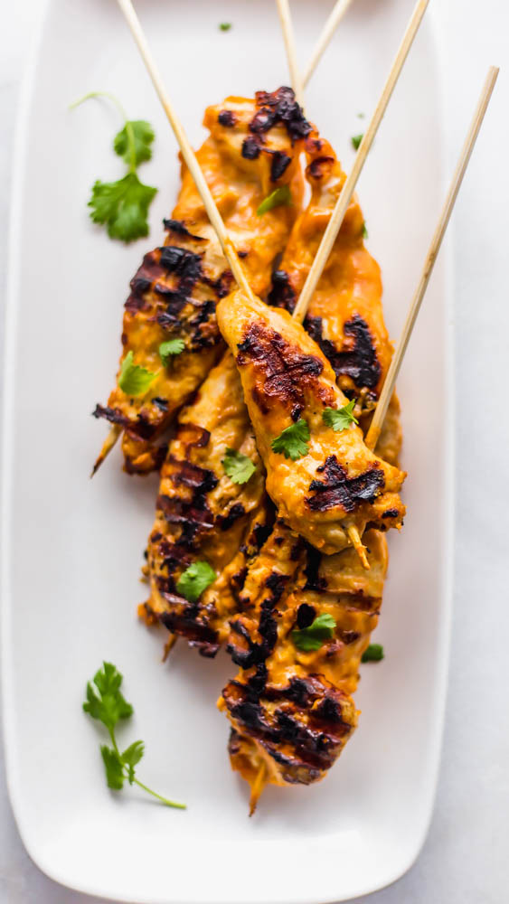 Easy, Thai inspired Whole30 Cashew Chicken Satay Skewers with Chili Cashew Dipping Sauce is the perfect, non-boring recipe you need to make for dinner. This healthy recipe has marinated chicken on skewers and is grilled to perfection. Served with a slightly spicy cashew dipping sauce it is so authentic and peanut free. Paleo and Whole30 Compliant #whole30 #paleo #dairyfree #glutenfree #dinner #healthy #healthyrecipe #recipe #dinnerrecipe #paleorecipe #whole30recipe
