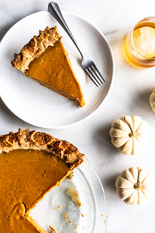 This Maple Bourbon Pumpkin Pie with Pecan Buttermilk Crust takes pumpkin pie to the next level. Impress your guests with this homemade masterpiece.