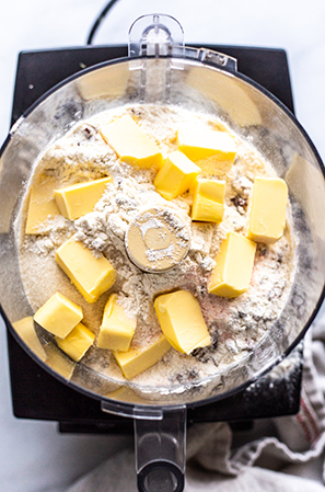 ingredients for pie crust with butter in a food processor