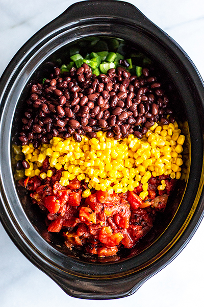 black beans, corn and tomatoes in a black slow cooker