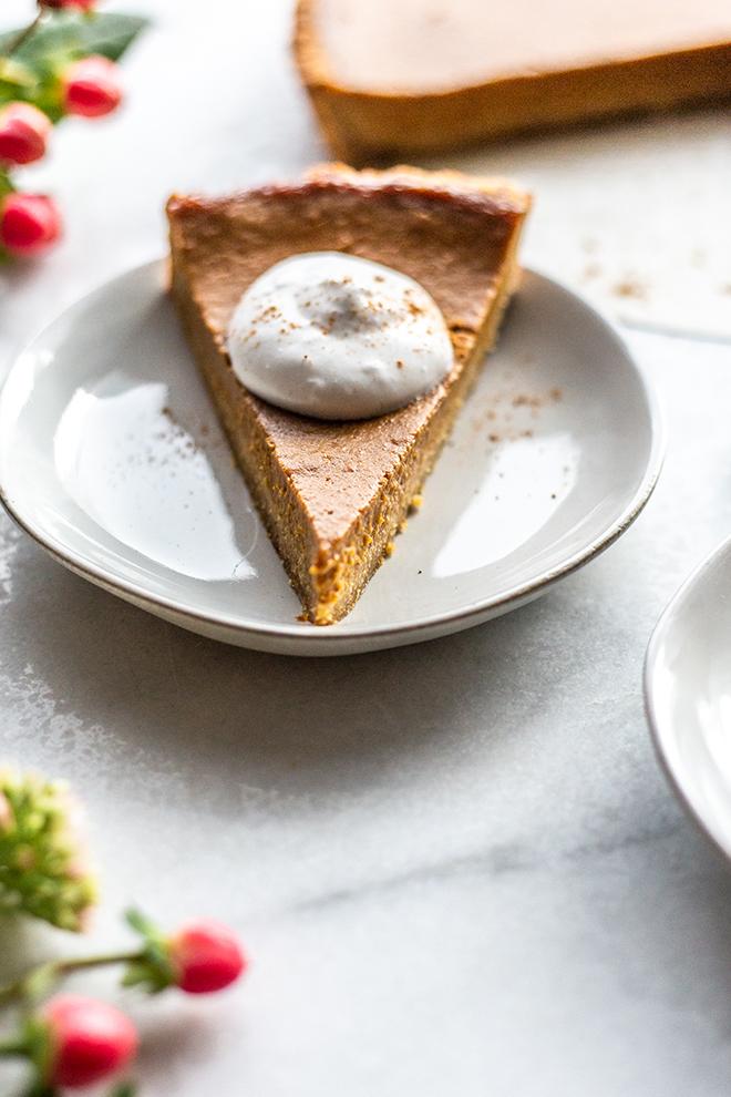 pumpkin tart slice with whipped cream
