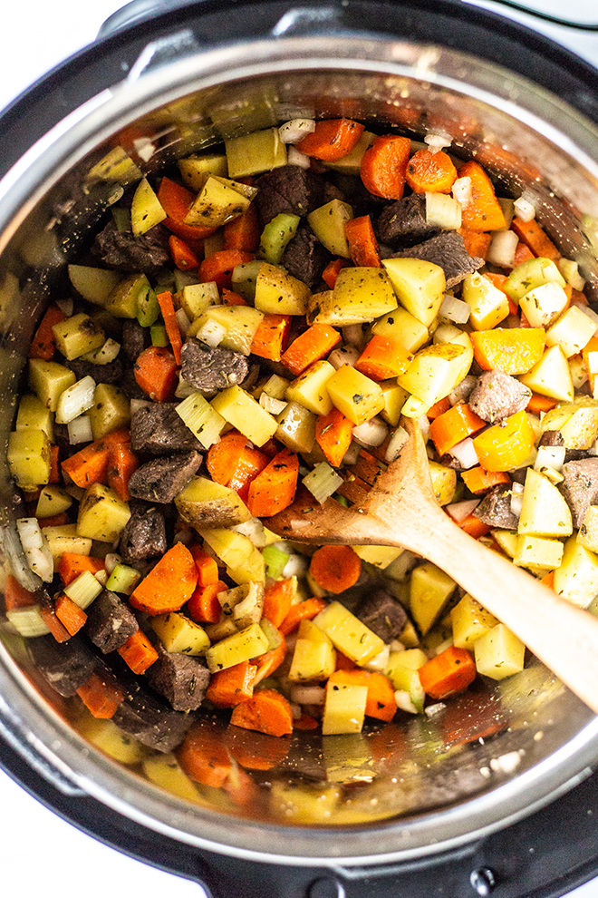vegetables and venison in an instant pot all diced up
