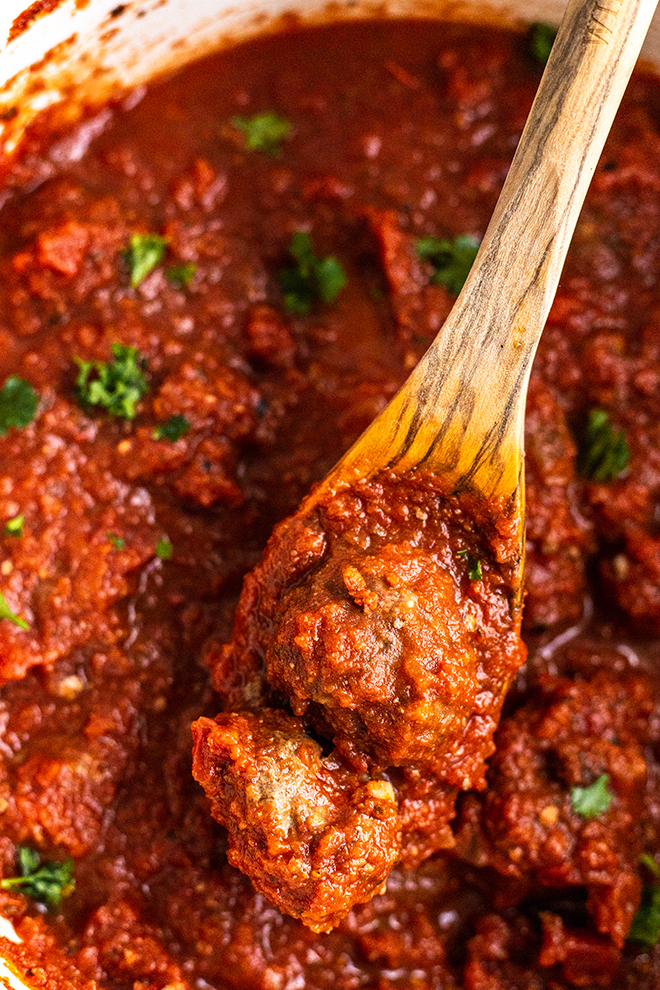 meatballs in sauce in a white pot