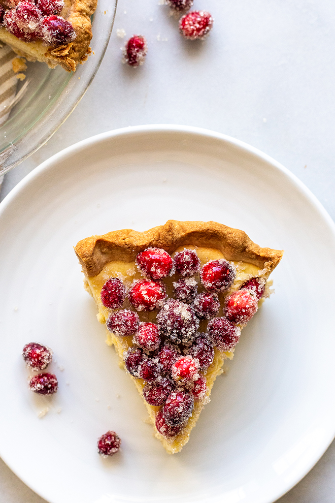 pie slice with cranberries on a white plate