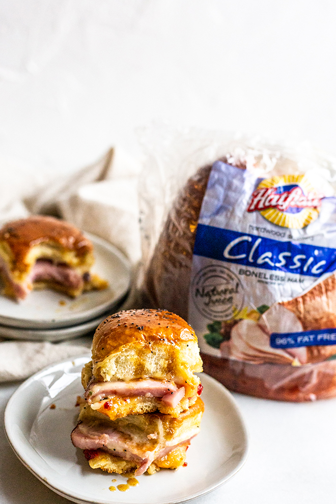 Red Peppery Jelly Ham Sliders are filled with thick slices of ham, spicy pepper jelly, and gooey Havarti cheese. They're the perfect Holiday lunch and you can use up some leftover ham!