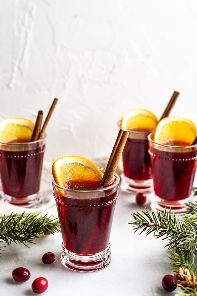 This 5 Ingredient Mulled Wine will warm your heart and knock your socks off it's so good. 5 simple ingredients come together on the stove or in a crockpot for a cup of cheer.