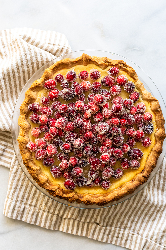 Delicious Buttermilk Cheesecake Pie bakes up like a rich cheesecake in pie crust with Sugared Cranberries to top it off with tartness and festivity.