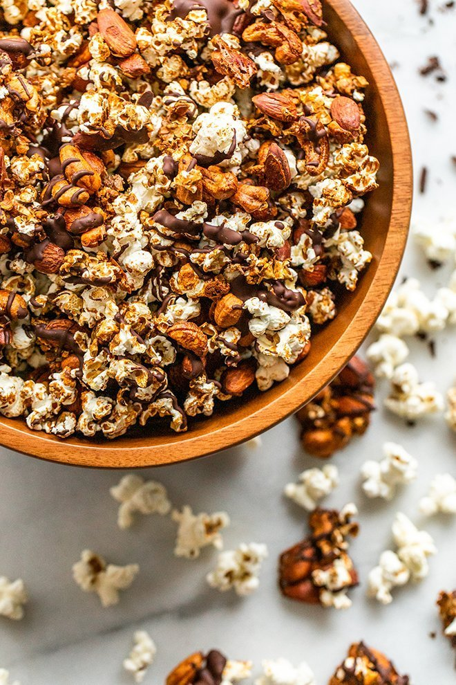 This Healthy Moose Munch snack mix is a salty and sweet treat. Dairy-free coconut caramel and a chocolate drizzle cover crunchy popcorn, almonds, and cashews.