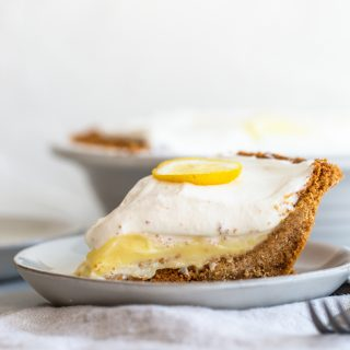 Crunchy and buttery graham cracker crust is filled with tart lemon filling and topped with fresh, lemon cream. A perfect, refreshing dessert.