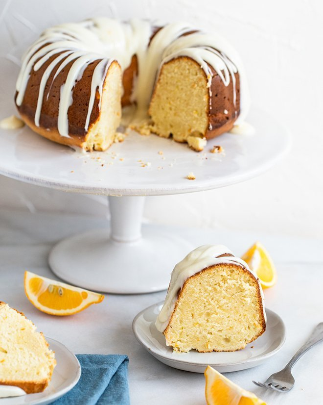 Decadent Meyer lemon flavored pound cake is baked in a bundt pan and covered in a sweet cream cheese glaze. Easy to make and beautiful to serve.