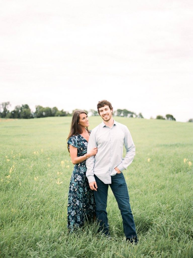 husband and wife in a green field