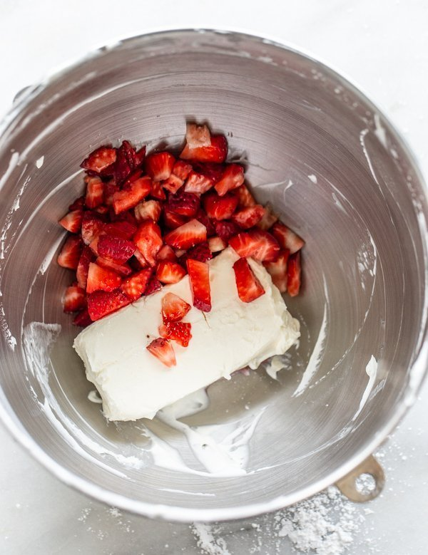 cream cheese and strawberries in a metal bowl