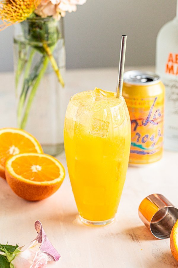 an orange crush in a clear tall glass