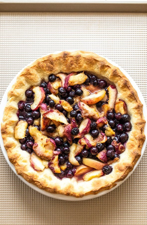 peaches and blueberries in a baked pie crust