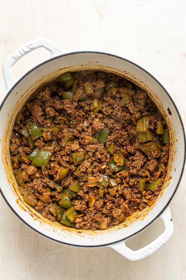 meat and peppers browned in a skillet