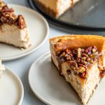 Pecan Pie Cheesecake slices on white plates