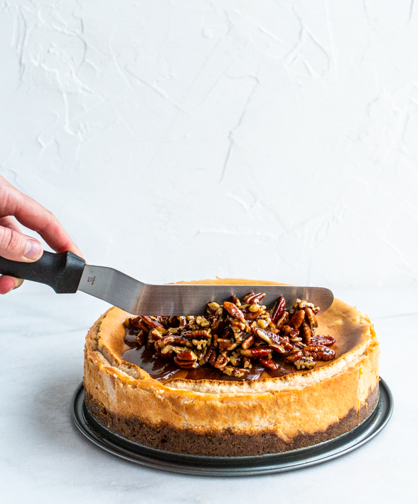 Pecan pie filling spread over cheesecake