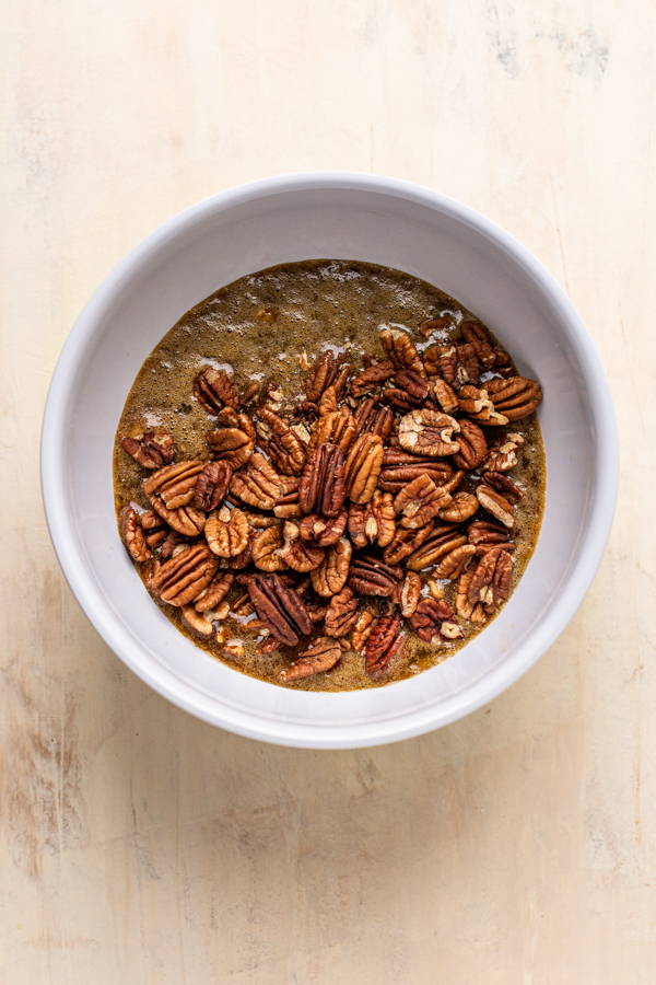 pecan pie filling in a white bowl