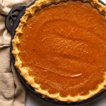 pumpkin pie baked in black, cast iron pie dish
