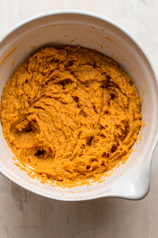 whipped sweet potatoes in a white bowl