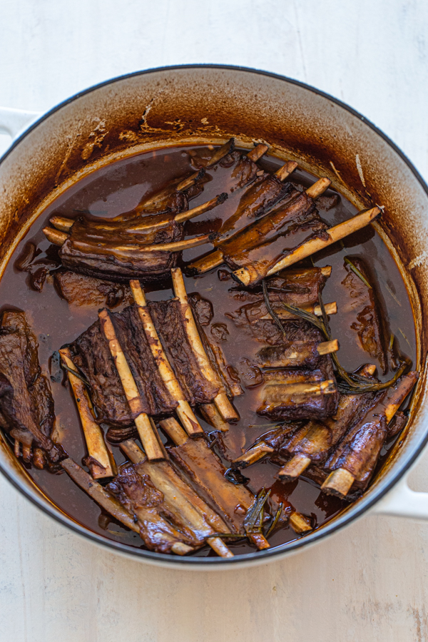 braised short ribs in liquid falling off the bone