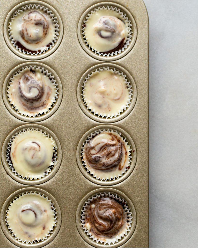 brownie cheesecake bites in mini muffin tins