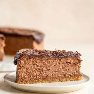 a slice of chocolate cheesecake on a white plate