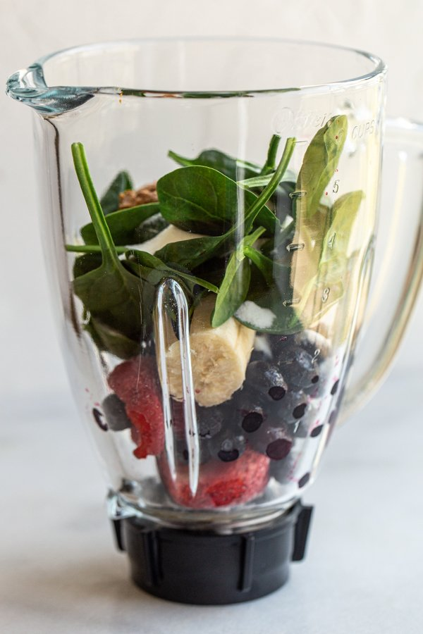 fresh produce in a blender for a smoothie