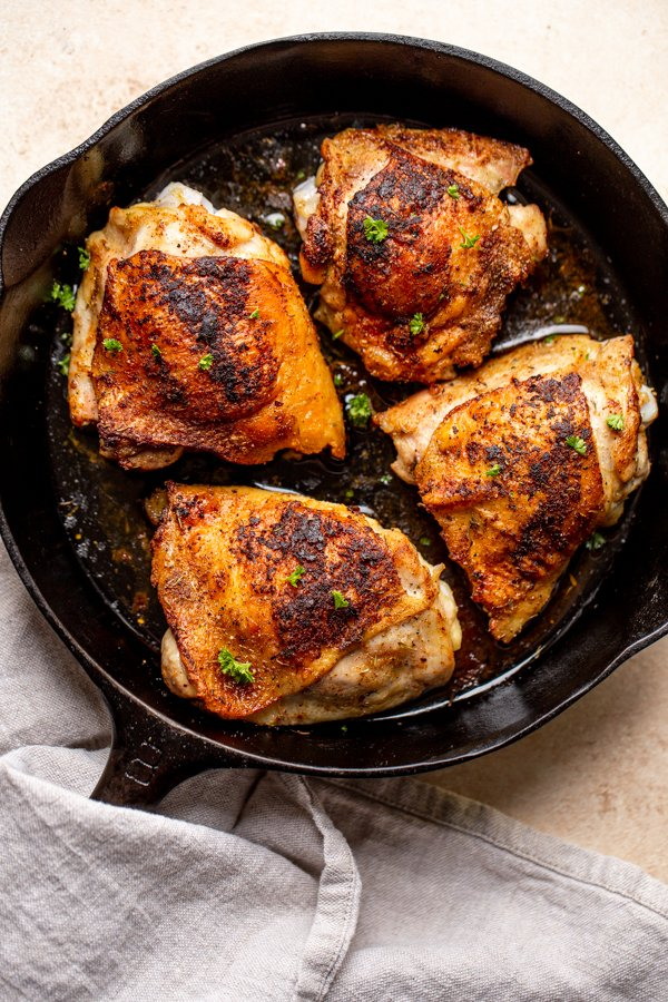 pan roasted chicken thighs in a pan