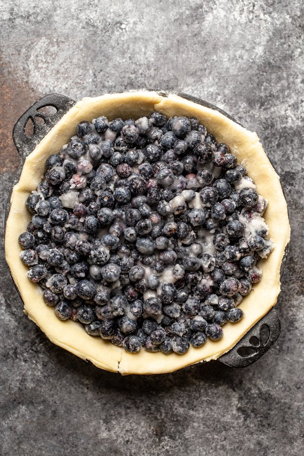 blueberry pie filling in a unbaked pie crust