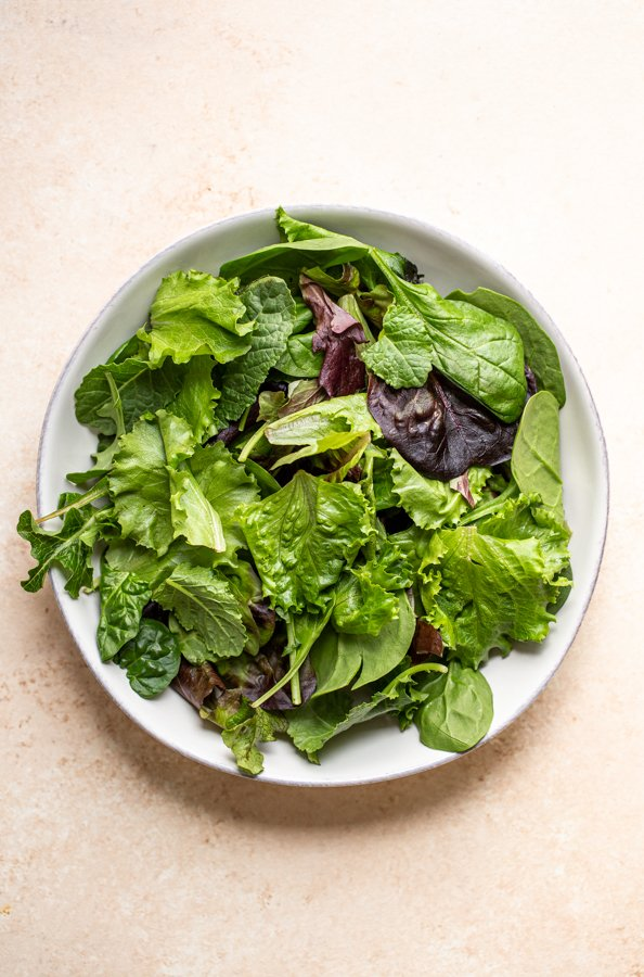leafy lettuce in a white bowl