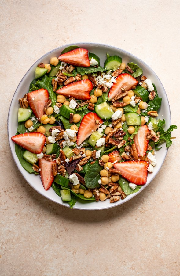 salad in a bowl with chickpeas, strawberry and feta