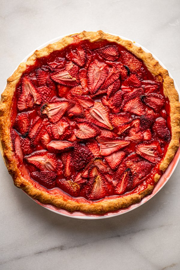 strawberry pie with fresh strawberries on a counter