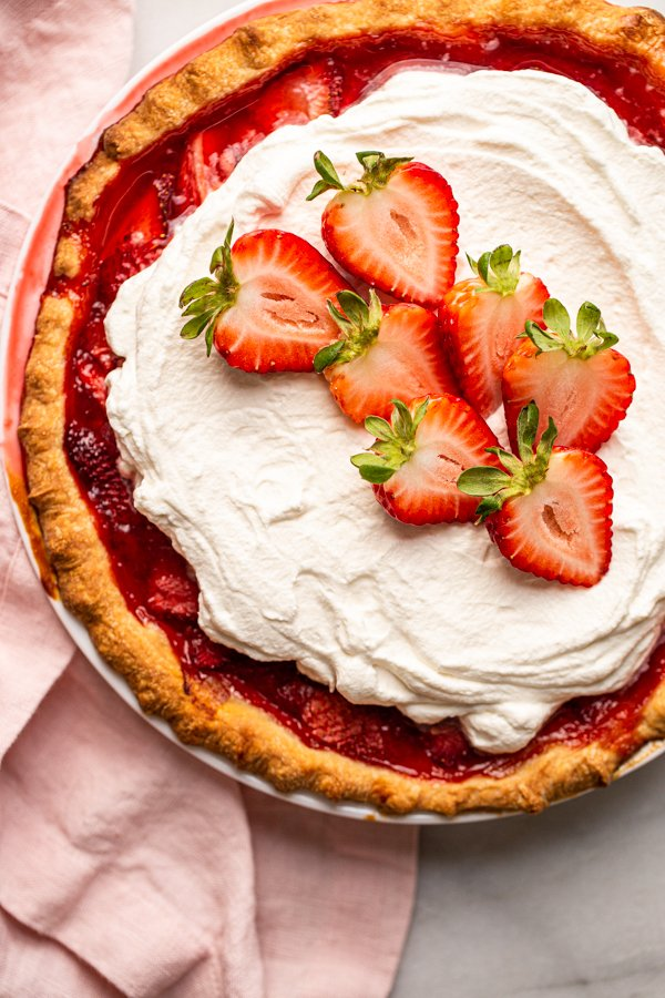 fresh strawberry pie with whipped cream on top