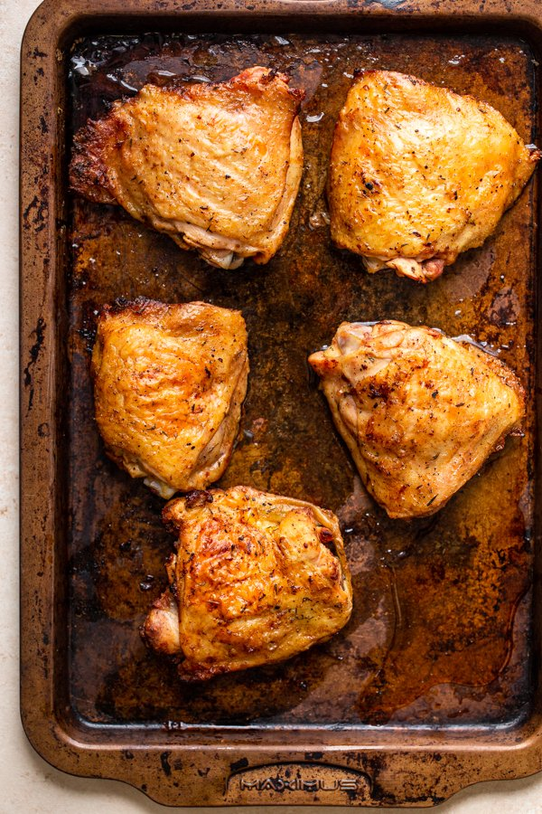 chicken thighs on a baking sheet