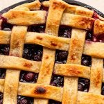 traeger pie with blueberries in a cast iron pie plate