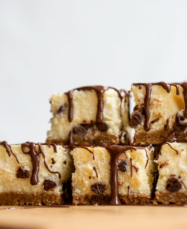 a stack of chocolate chip cheesecake bars